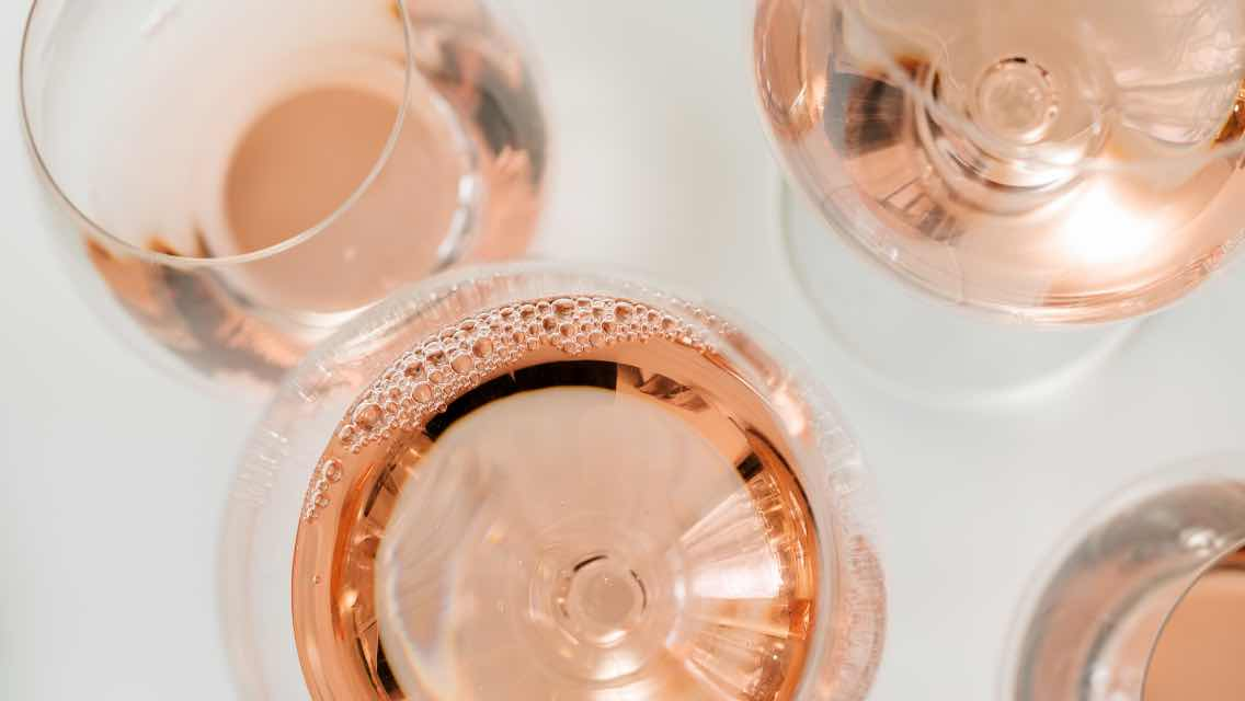 Multiple glasses of rose.